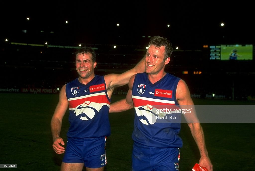 Brad Johnson and Chris Grant of the Western Bulldogs celebrate after the AFL Premiership Round 5 match against the Richmond Tigers at the MCG, Melbourne, Australia. The game finished with Wests (143) defeating Richmond (81). \ Mandatory Credit: Hamish Blair /Allsport