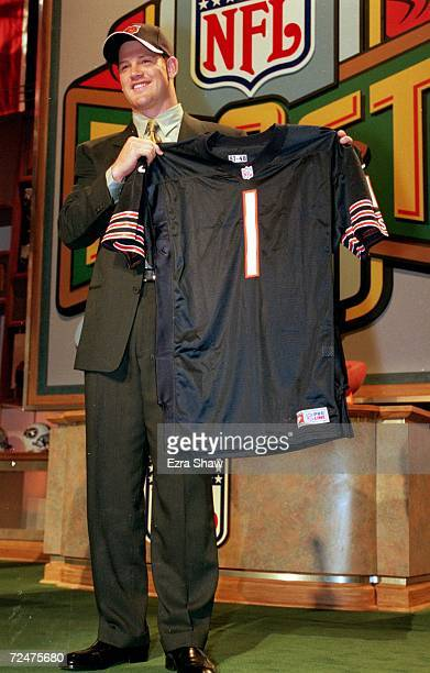 Cade McNown holds up his new jersey after being drafted by the Chicago Bears Mandatory Credit Ezra O Shaw /Allsport