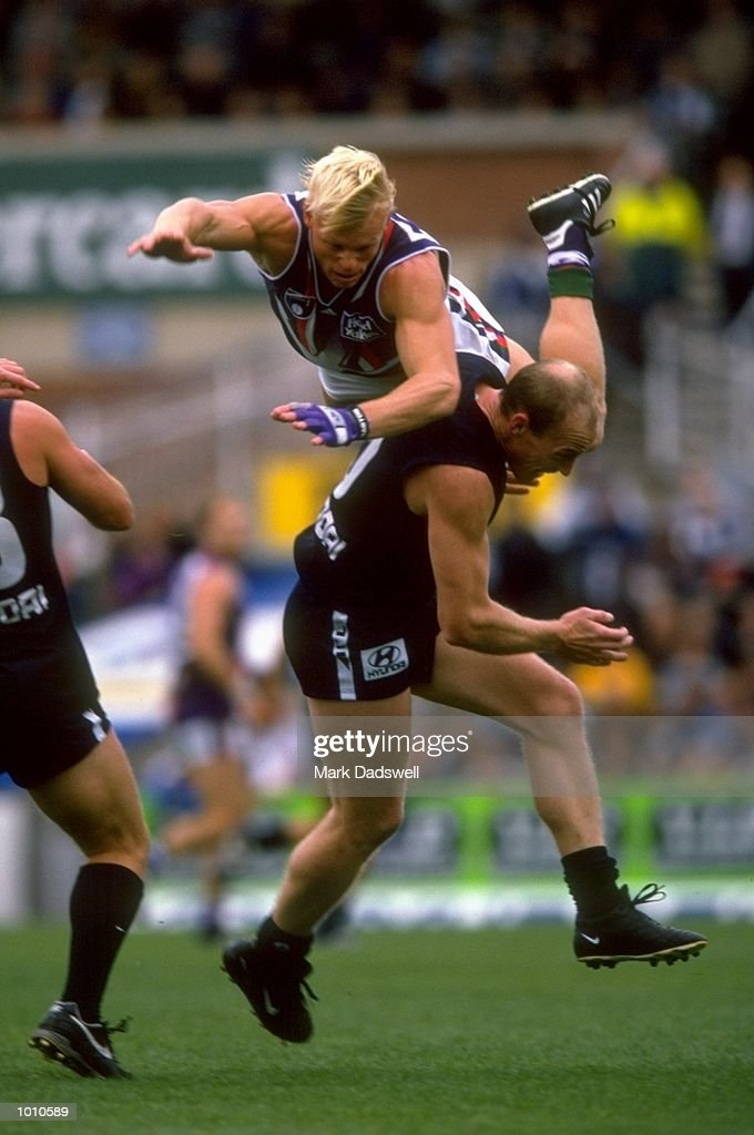 Clive Waterhouse of Fremantle climbs over Andrew McKay of Carlton during the 1999 AFL Premiership Round 4 game, where Carlton (121) defeated Fremantle (92), at the Optus Oval, Melbourne, Australia. \ Mandatory Credit: Mark Dadswell /Allsport