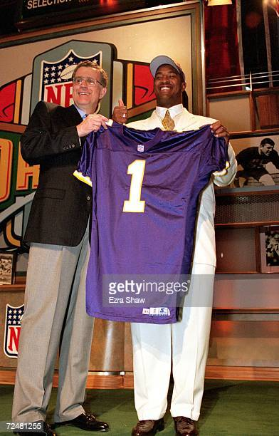 Daunte Culpepper of the Minnesota Vikings stands next to the NFL Commisioner Paul Tagliabue and holds up his Vikings jersey during the NFL Draft at...
