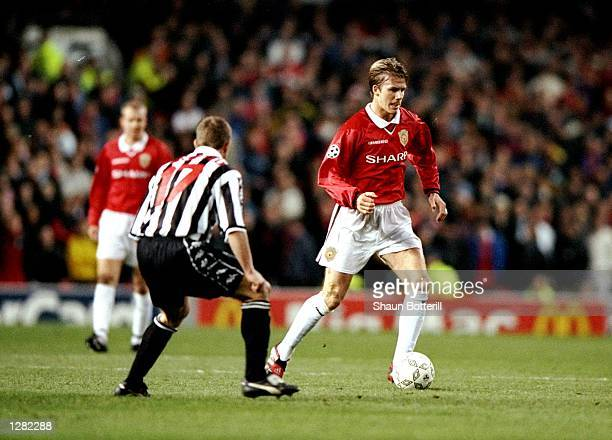 David Beckham of Manchester United is watched by Gianluca Pessotto of Juventus in the UEFA Champions League semifinal first leg match at Old Trafford...