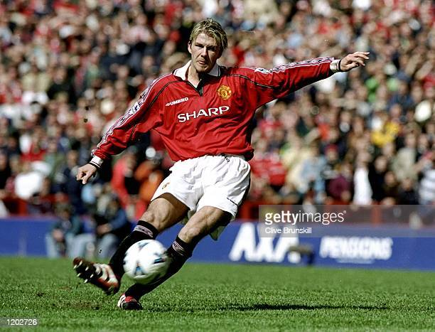 David Beckham of Manchester United taking a freekick during the AXA FA Cup semifinal match against Arsenal played at Villa Park in Birmingham England...
