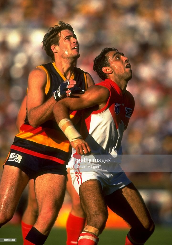 David Pittman of the Adelaide Crows challenges for the ball with Sydney Swans'' Adam Goodes during the AFL Premiership Round 5 match at Football Park, Adelaide, Australia. The Anzac Day game finished with the Adelaide Crows (155) defeating the Sydney Swans (74). \ Mandatory Credit: Stuart Milligan /Allsport