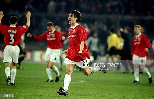 Gary Neville of Manchester United celebrates victory over Juventus in the UEFA Champions League semifinal second leg match at the Stadio delle Alpi...