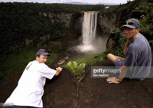 Glenn McGrath and Steve Waugh of Australia relax near a waterfall during the One Day International tour match against the West Indies in Bardados...