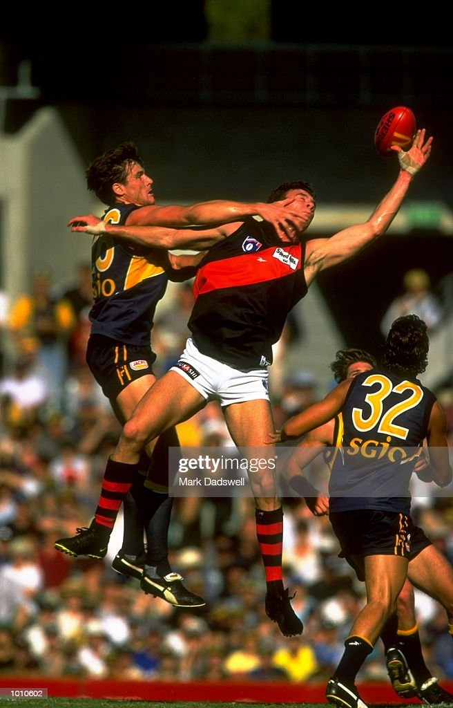 Jason Ball of the West Coast Eagles attempts to stop Steve Alessio of the Essendon Bombers taking a one handed catch during the 1999 AFL Premiership Round 4 match, where the West Coast (97) defeated Essendon (23) at the Subiaco Oval, Perth, Australia. \ Mandatory Credit: Mark Dadswell /Allsport