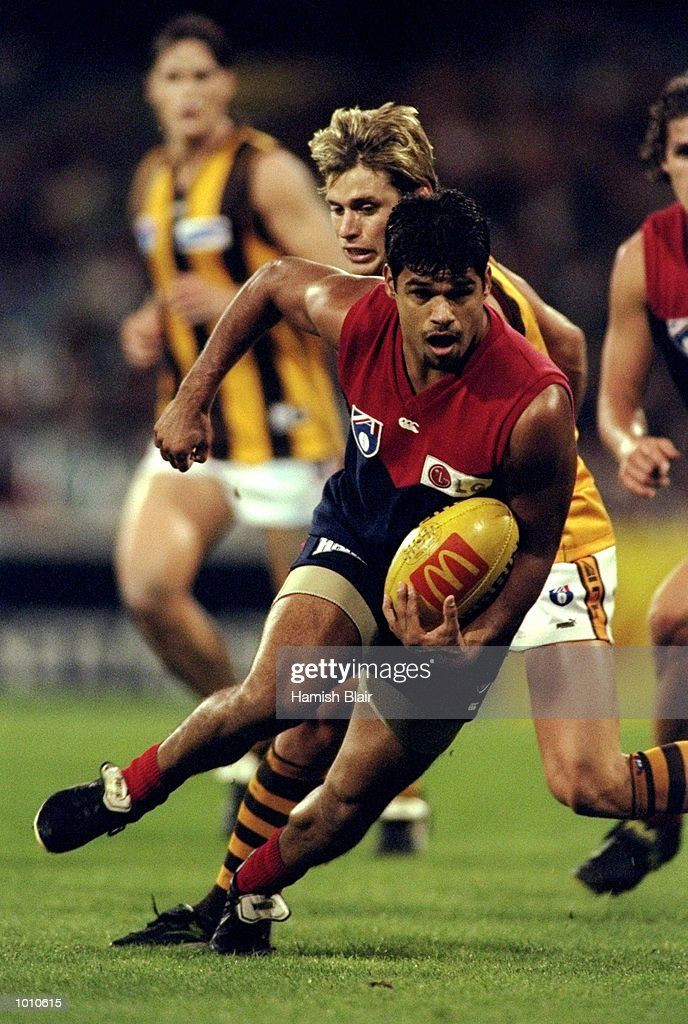 Jeff Farmer of Melbourne is pursued by Hawthorn's Shane Crawford during the 1999 AFL Premiership Round 4 match, where the Melbourne Demons (85) defeated the Hawthorn Hawks (84), at the MCG, Melbourne, Australia. \ \ Mandatory Credit: HamishBlair /Allsport