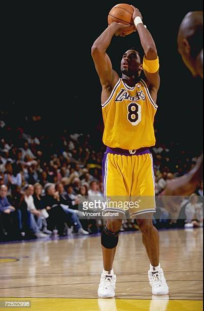 Kobe Bryant of the Los Angeles Lakers shoots a free throw during the game against the Vancover Grizzlies at the Great Western Forum in Inglewood...