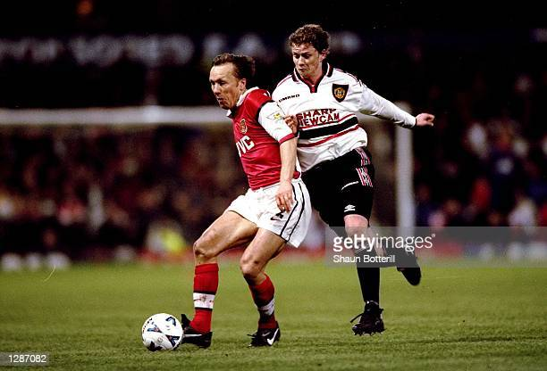 Lee Dixon of Arsenal is closed down by Ole Gunnar Solskjaer of Manchester United in the FA Cup semifinal replay at Villa Park in Birmingham England...