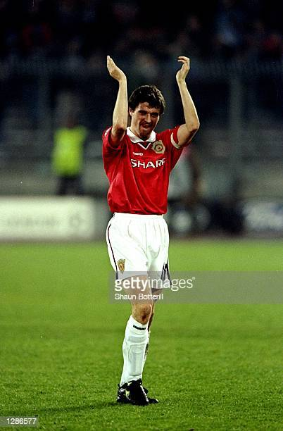 Manchester United captain Roy Keane applauds the fans after leading his team to victory over Juventus in the UEFA Champions League semifinal second...