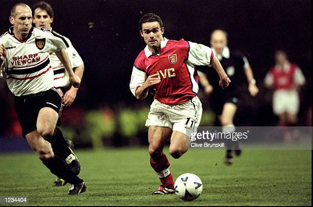 Marc Overmars of Arsenal in action during the FA Cup Semi Final Replay match against Manchester United played at Villa Park in Birmingham England...