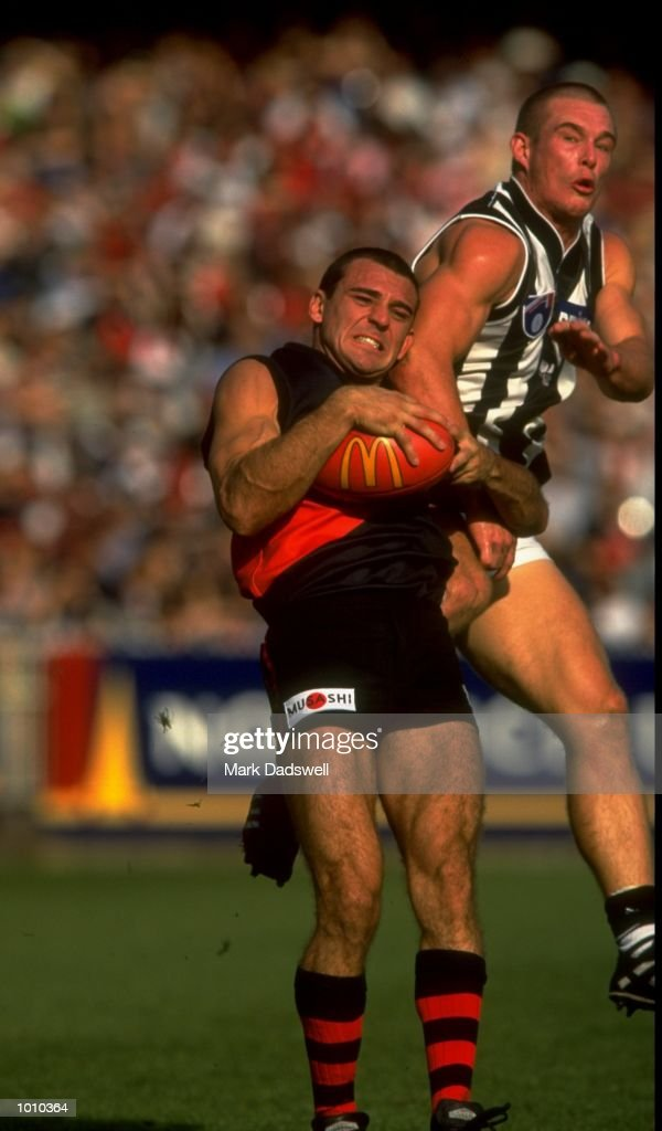 Mark Mercuri of the Essendon Bombers tussles with Collingwood Magpies'' Luke Godden during the AFL Premiership Round 5 match at the MCG, Melbourne, Australia. The Anzac Day game finished with Essendon (108) defeating Collingwood (100). \ Mandatory Credit: Mark Dadswell /Allsport