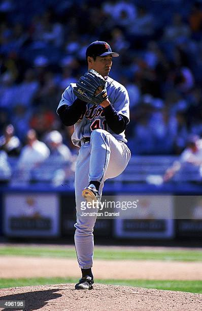 Masao Kida of the Detroit Tigers winds back to pitch the ball during a game against the Chicago White Sox at Comisky Park in Chicago Illinois The...
