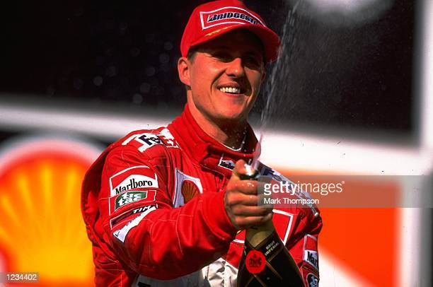 Michael Schumacher of the Ferrari team celebrates coming in second place during the 1999 Brazilian Grand Prix held at the Interlagos Circuit in Sao...