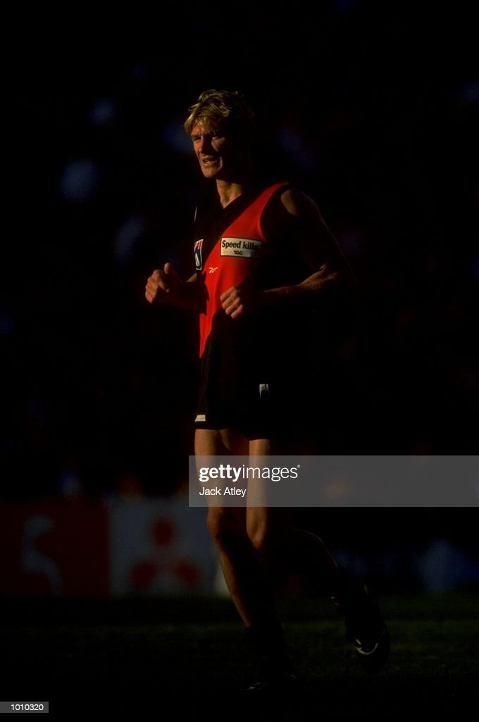 Michael Symons of the Essendon Bombers in action during the AFL Premiership Round 5 match against the Collingwood Magpies at the MCG, Melbourne, Australia. The Anzac Day game finished with Essendon (108) defeating Collingwood (100). \ Mandatory Credit: Jack Atley /Allsport
