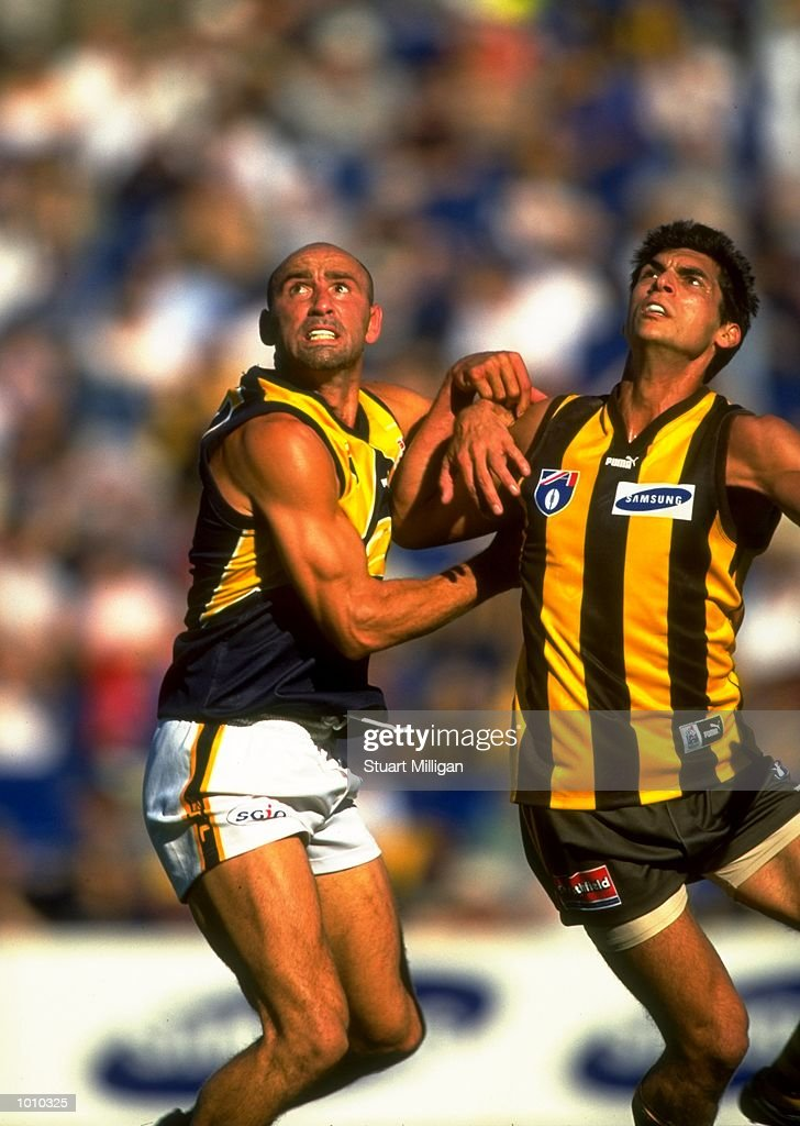 Peter Matera of the West Coast Eagles in a tussle with Hawthorn Hawks'' Michael Collica during the AFL Premiership Round 5 match at Waverley Park, Melbourne, Australia. The game finished with West Coast (94) defeating Hawthorn (64).\ Mandatory Credit: Stuart Milligan /Allsport