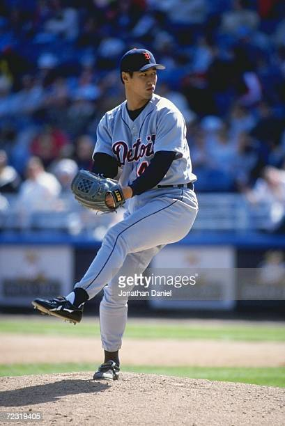 Pitcher Masao Kida of the Detroit Tigers winds up for the pitch during the game against the Chicago White Sox at Comiskey Park in Chicago Illinois...