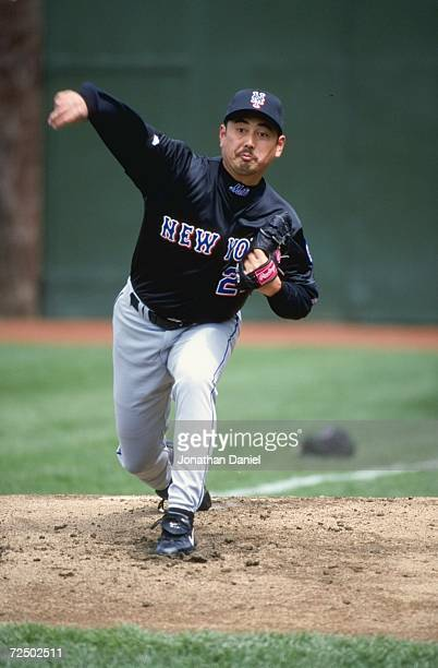 Pitcher Masato Yoshii of the New York Mets pitches the ball during the game against the Chicago Cubs at the Wrigley Field in Chacago Illinois The...