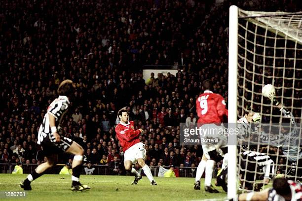 Ryan Giggs of Manchester United scores a late equaliser in the UEFA Champions League semifinal first leg match against Juventus at Old Trafford in...