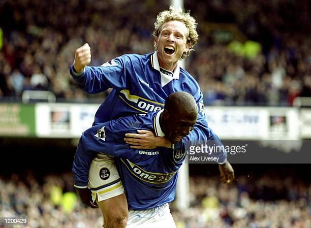 Scott Gemmill of Everton celebrates on Kevin Campbell shoulders during the FA Carling Premeirship match against Charlton at the Goodison Park in...