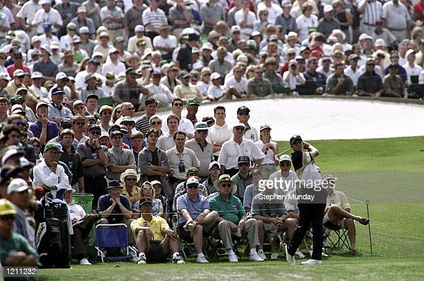Sergio Garcia of Spain tees off on the third watched by the crowd during the 1999 US Masters at the Augusta National GC in Augusta Georgia USA...