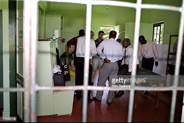 Steve Waugh of Australia and match officials talk as the crowd riots after the One Day International match played in Barbados Mandatory Credit Ben...