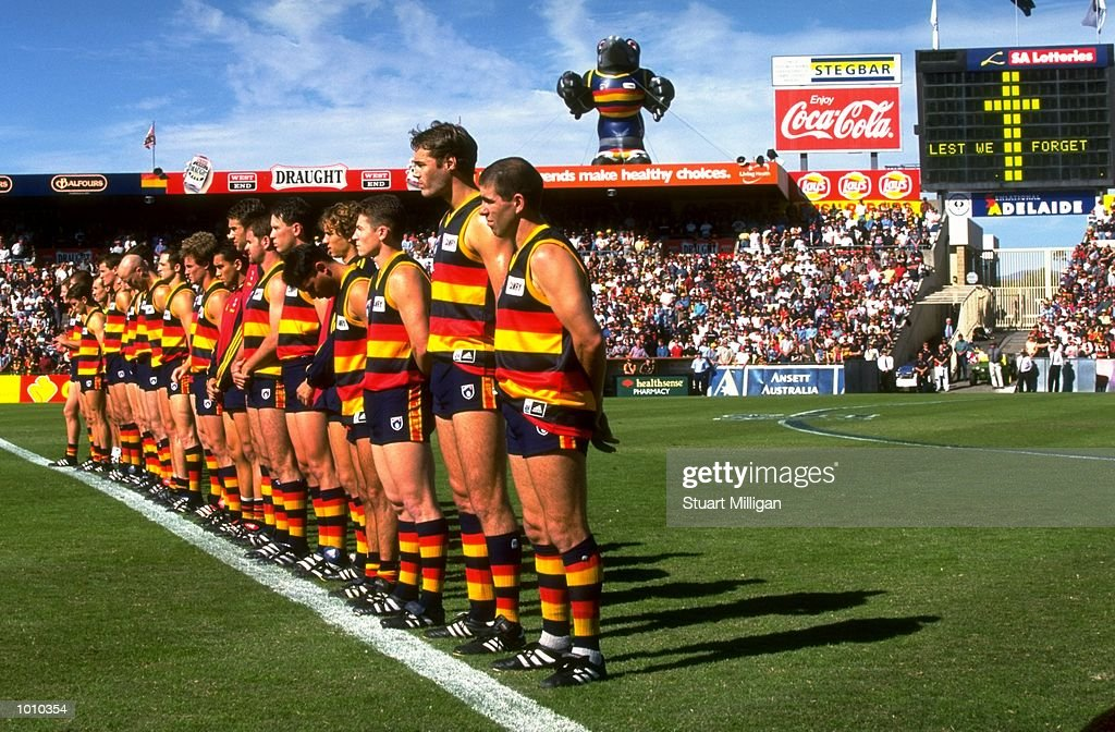 The Adelaide Crows line up for the anthem prior to the AFL Premiership Round 5 match against the Sydney Swans at Football Park, Adelaide, Australia. The Anzac Day game finished with the Adelaide Crows (155) defeating the Sydney Swans (74).\ Mandatory Credit: Stuart Milligan /Allsport