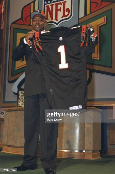 The third draft pick Akili Smith holds his new Cincinnati Bengals jersey during the NFL Draft at the Madison Square Garden in New York, New York.