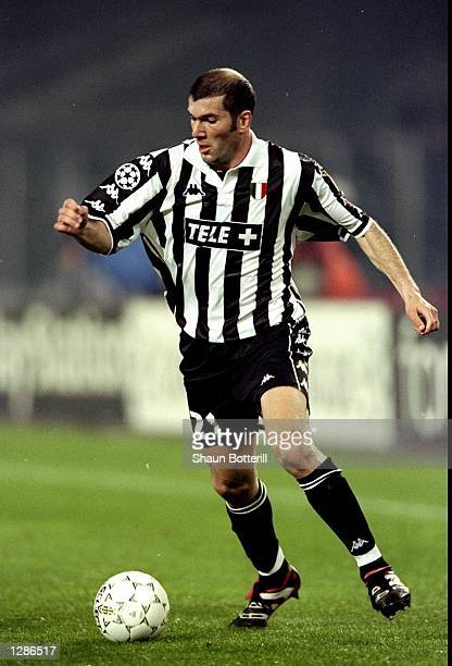 Zinedine Zidane of Juventus on the ball against Manchester United in the UEFA Champions League semifinal second leg match at the Stadio delle Alpi in...