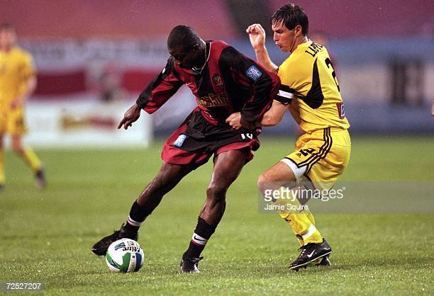 Adolfo Valencia of the New Jersey/New York MetroStars dribbles the ball while being guarded by Mike Lapper during the game against the Columbus Crew...