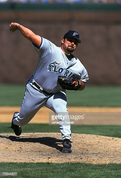 Alex Fernandez of the Florida Marlins winds back to pitch the ball during a game against the Chicago Cubs at Wigley Field in Chicago Illinois The...