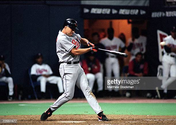 Cal Ripken Jr. #8 of the Baltimore Orioles hits number 3,000 during the game against the Minnesota Twins at the Hubert H. Humphrey Metrodome in...