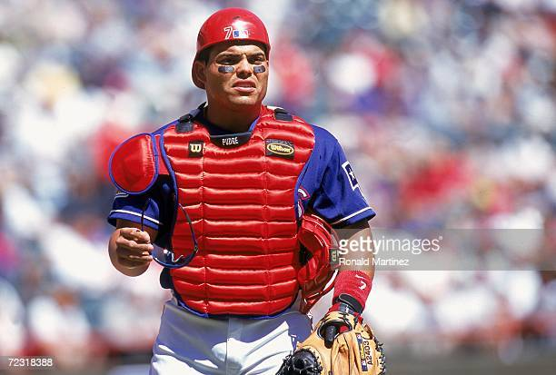 Catcher Ivan Rodriguez of the Texas Rangers looks on the field during the game against the Chicago White Sox at The Ballpark in Arlington Texas The...