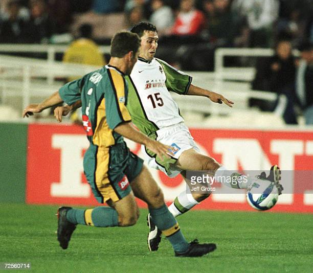 Chad Deering of the Dallas Burn controls the ball as Greg Vanney of Los Angeles Galaxy gives chase during their game at the Rose Bowl in Pasadena...