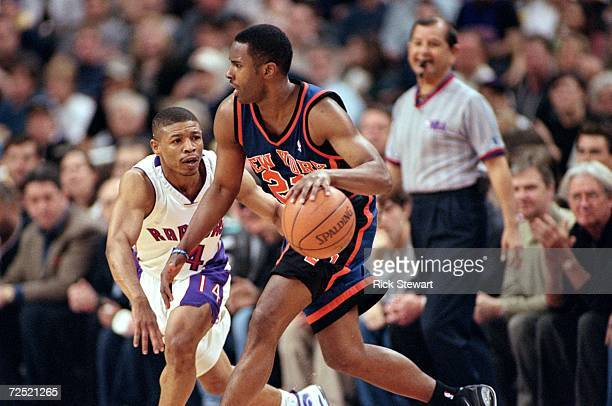 Charlie Ward of the New York Knicks moves with the ball around Muggsy Bogues of the Toronto Raptors during the NBA Eastern Conference Round One Game...