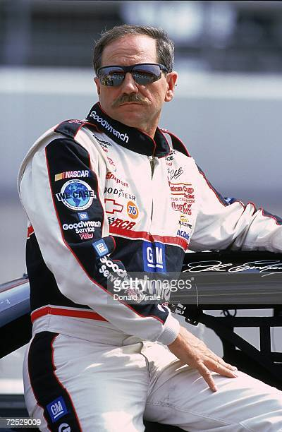Dale Earnhardt Sr #3 relaxes while watching the action during the NAPA Auto Parts 500 Part of the NASCAR Winston Cup Series at the California...