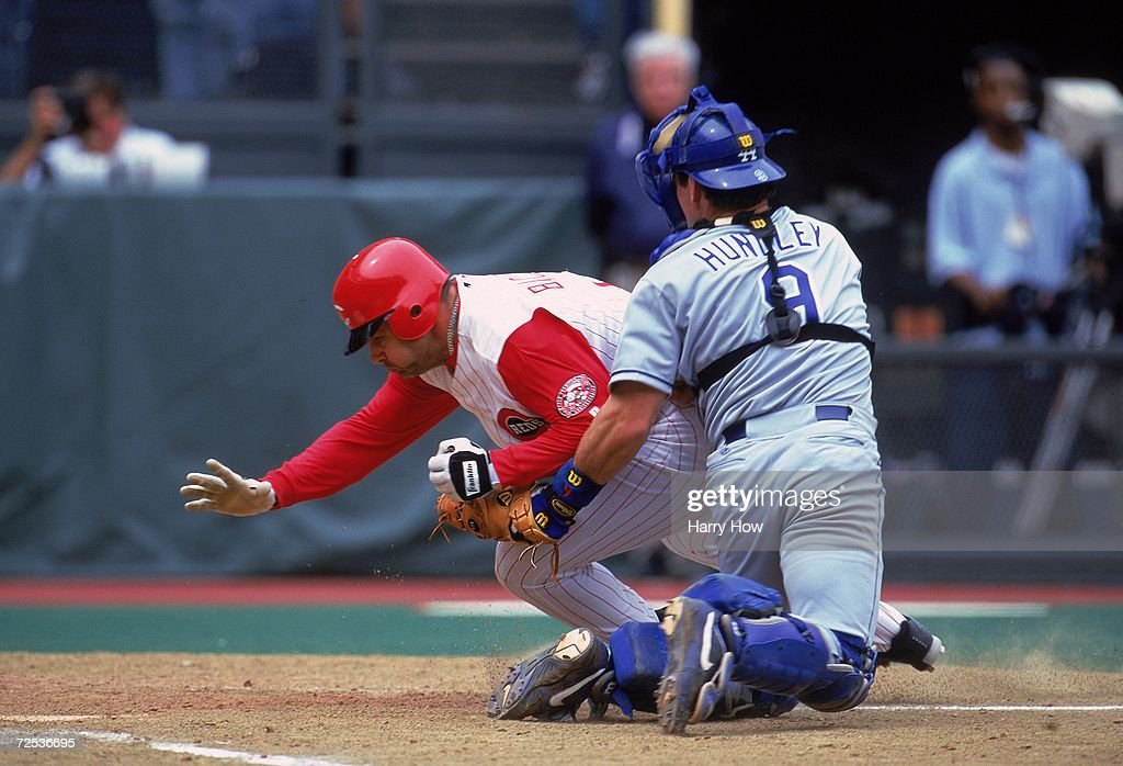 Dante Bichette #9 of the Cincinnati Reds comes into home plate as Catcher Todd Hundley #9 of the Los Angeles Dodgers tries to tag him out during the game against at Cinergy Field in Cincinnati, Ohio. The Dodgers defeated the Reds 11-3. Mandatory Credit: Harry How /Allsport