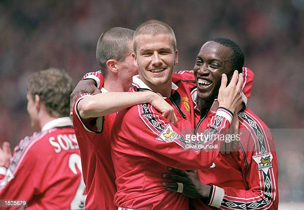 David Beckham Roy Keane and Dwight Yorke of Manchester United celebrate during the FA Carling Premiership game between Manchester United and Chelsea...