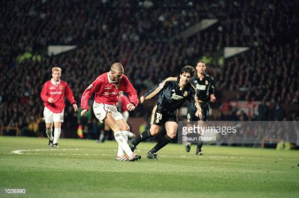 David Beckham scores the first goal for Manchester United during the UEFA Champions League quarterfinal second leg against Real Madrid at Old...