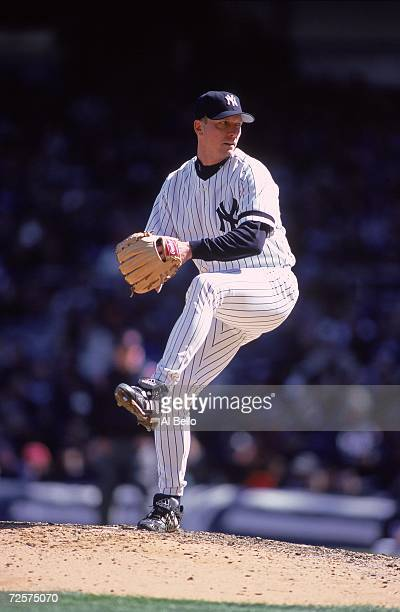 David Cone of the New York Yankees winds back to pitch the ball during the game against the Texas Rangers at the Yankee Stadium in Bronx New York The...