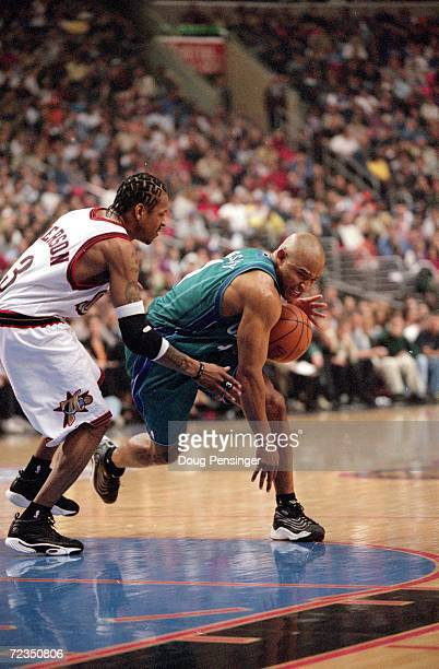David Wesley of the Charlotte Hornets dribbles the ball as he is guarded by Allen Iverson of the Philadelpha 76ers during the NBA Eastern Conference...