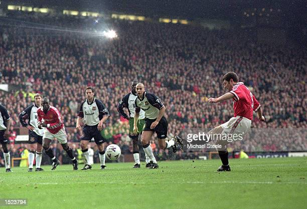 Denis Irwin of Manchester United misses a penalty but follows up to score during the FA Carling Premiership match against West Ham United at Old...
