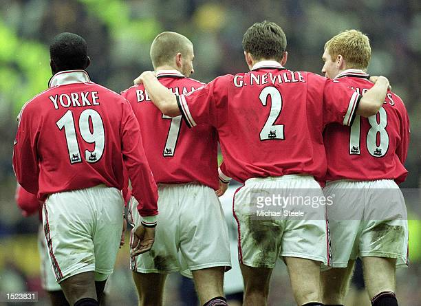 Dwight Yorke David Beckham Gary Neville and Paul Scholes of Manchester United celebrate against West Ham United during the FA Carling Premiership...