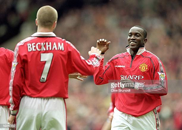 Dwight Yorke of Manchester United celebrates his goal with team mate David Beckham during the FA Carling Premiership match against Chelsea at Old...