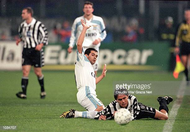 Filippo Inzaghi of Juventus goes down after a challenge from Sergio Conceicao of Lazio during the Italian Serie A match played at the Stadio Delle...