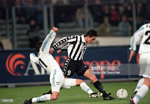 Filippo Inzaghi of Juventus goes past Sinisa Mihajlovic of Lazio during the Italian Serie A match played at the Stadio Delle Alpi in Turin Italy...