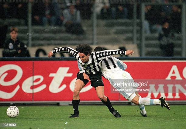 Filippo Inzaghi of Juventus looks to be held by Sinisa Mihajlovic of Lazio during the Italian Serie A match played at the Stadio Delle Alpi in Turin...