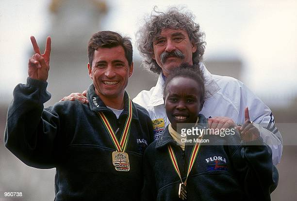 Flora London Marathon winners Antonio Pinto of Portugal and Tegla Lorupe of Kenya with Race Director David Bedford in London England Mandatory Credit...