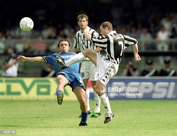 Gianluca Pessotto of Juventus gets in a challenge during the Italian Serie A match against Verona at the Stadio Bentegodi in Verona Italy Mandatory...