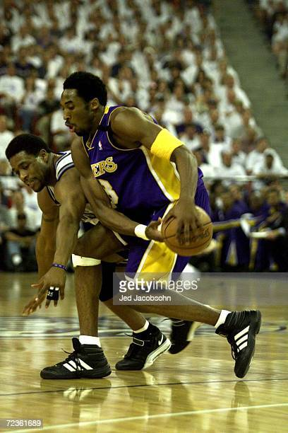 Guard Kobe Bryant of the Los Angeles Lakers keeps the ball away from on Nick Anderson of the Sacramento Kings during game 3 of the first round of the...